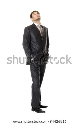 young businessman looking up  isolated on white