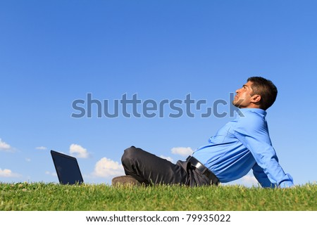 young businessman relaxing at the park