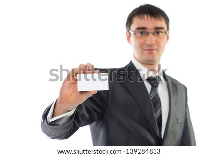 young businessman showing a business card, isolation image