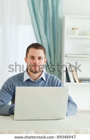 Young businessman sitting in his home office