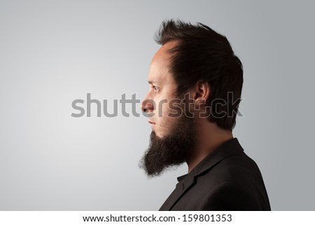 Young businessman thinking with copyspace on color background