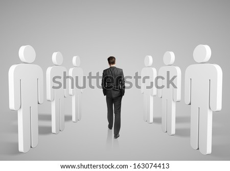 young businessman walking among 3d people