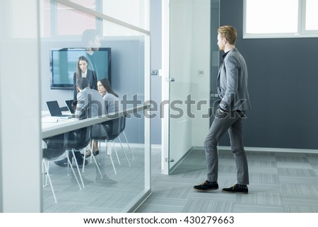 Young businessman walking through the modern office