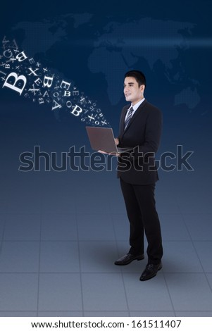 Young businessman working on his laptop, concept of internet chat and communication