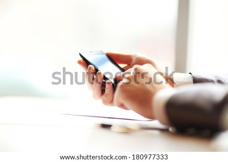 Young businessman working with modern devices, mobile phone.