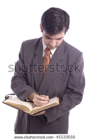 young businessman writing in his agenda isolated over white background