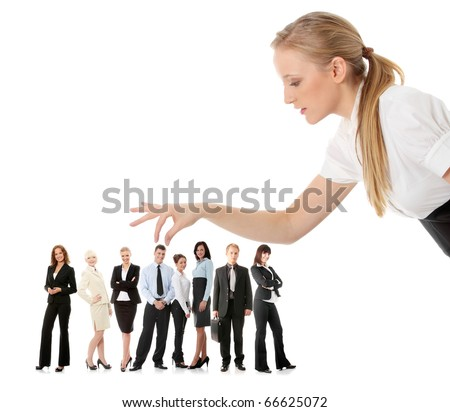 Young businesswoman choosing worker from group of businesspeople, isolated on white.
