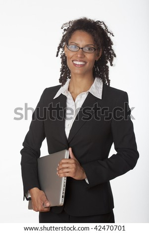 Young businesswoman holding laptop. Vertically framed shot.