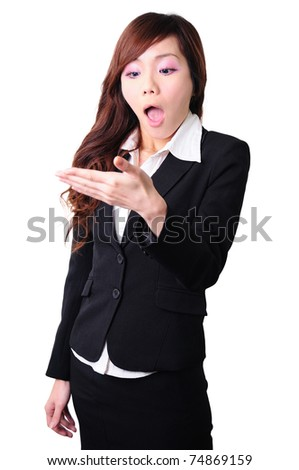 young businesswoman looking at her hand and looking surprised