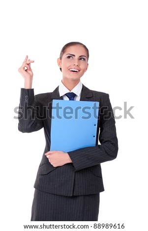 Young businesswoman standing with file folder smiling