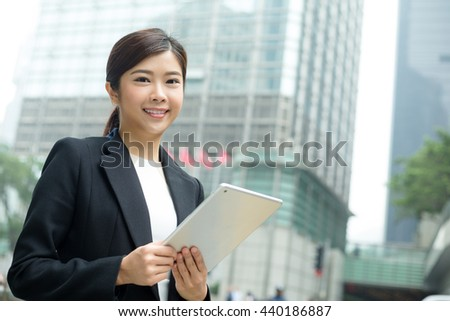 Young Businesswoman use of digital tablet