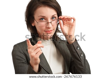 young businesswoman with glasses in hand pointing a finger