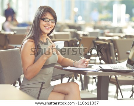 Young businesswoman working outdoors