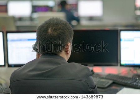 Young call center agent looking for a solution in his computer