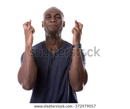 young casual black man scared and hoping on white background