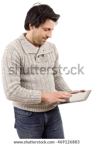 young casual man looking to his tablet pc, isolated