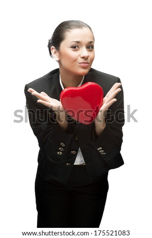 young caucasian business woman in black suit holding red heart isolated on white