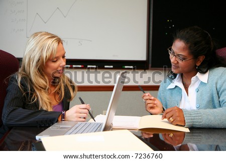 Young caucasian businesswoman with coworkers in an office setting
