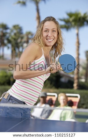 Young caucasian woman playing table tennis