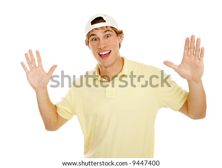 Young college age man throws up his hands in surprise.  Isolated on white.