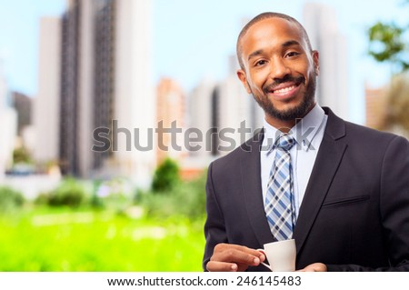 young cool black man having a coffee