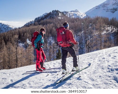 Young couple doing ski touring winter activity