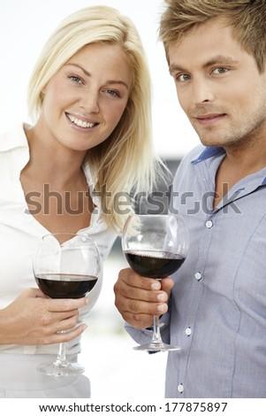 Young couple enjoying red wine