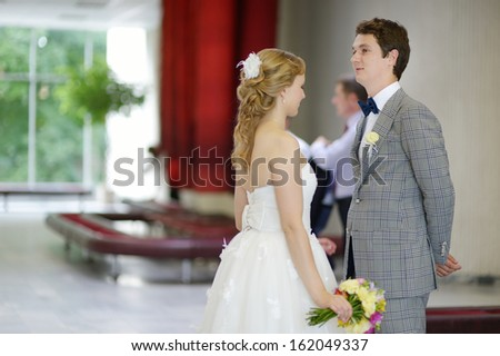 Young couple getting married in a registry office