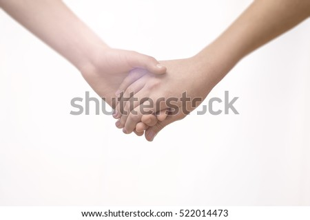 Young Couple Holding Hands Closeup. Friendship, Love and Valentines Day Concept.