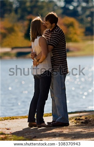 Young Couple In Love Share Romantic Kiss