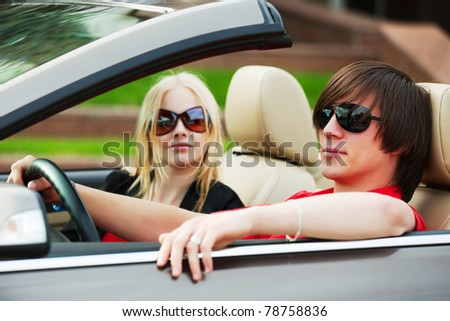 Young couple in the convertible