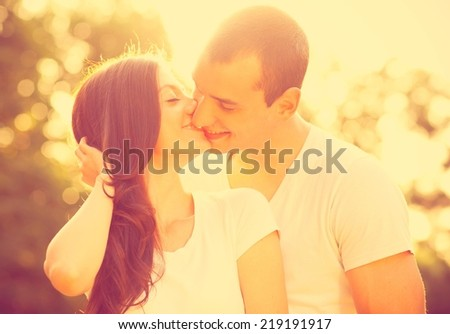 Young couple kissing in the park.