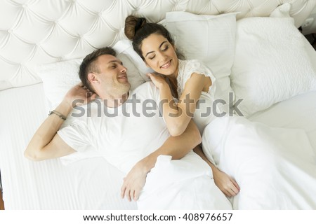 woman trying fall asleep while man stock photo 226828123 shutterstock. Black Bedroom Furniture Sets. Home Design Ideas