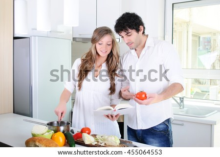 young couple looking at the cook book with recipes