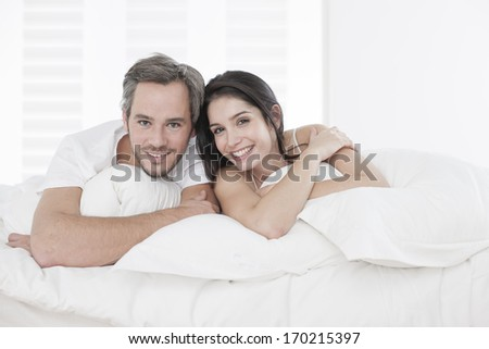 Young couple lying together in bed in the bedroom. Lovely Couple Sleeping White Bed Stock Photo 404883124   Shutterstock