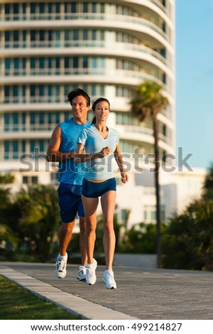 Young Couple Man and Woman Running Morning