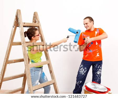 Young couple playing with tools during home renovation