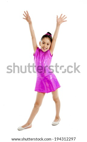 young cute Ballet dancer ballerina little girl dancing wearing a pink dress isolated on a white background doing the splits