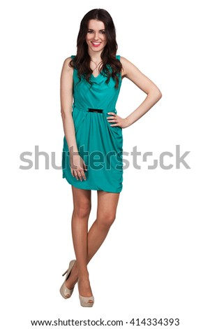 Young cute woman in green posing on white background