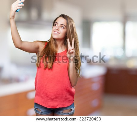 young cute woman taking a selfie on white background