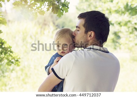 Young dad with a baby daughter