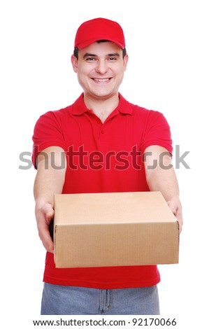 Young delivery man in red uniform holding the parcel box on white background