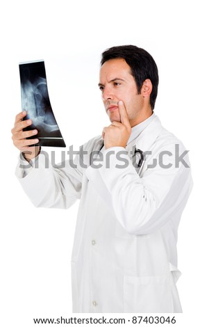 Young doctor examining an x-ray, isolated on white