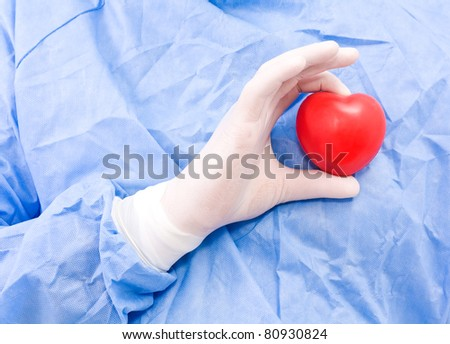 Young doctor with heart in his hand