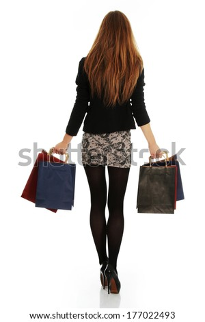 Young elegant blond woman with shopping bags, isolated on white background