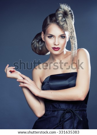young elegant woman with creative hair style leopard print close up halloween stylish