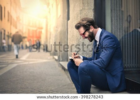 Young employee sitting outdoors