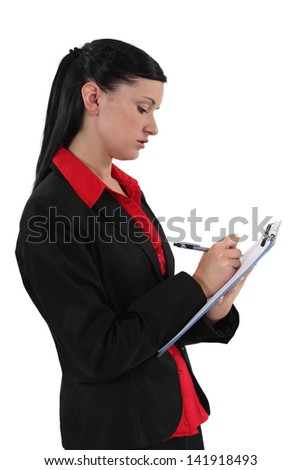 Young employee writing on a notepad