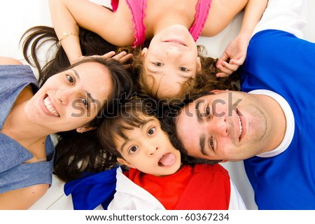 Young family having fun on the floor .