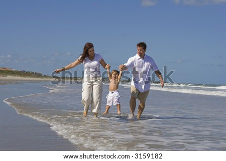 Young family heaving fun on a beach